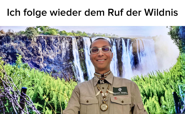 Benny Rebel in seinem Büro in Hannover, vor dem Bild der Viktoria Wasserfälle